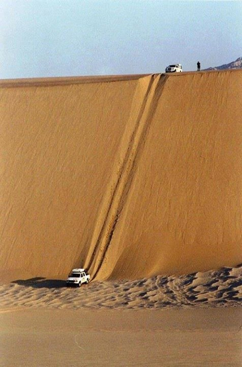 Crazy sand dune hill climbing truck roll over
