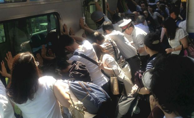 Commuters Help Rescue Woman Trapped Between Train & Platform