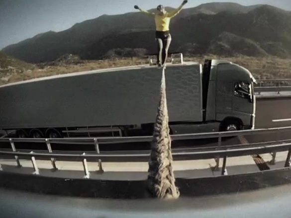 Tightrope Walk Between Two Speeding Trucks