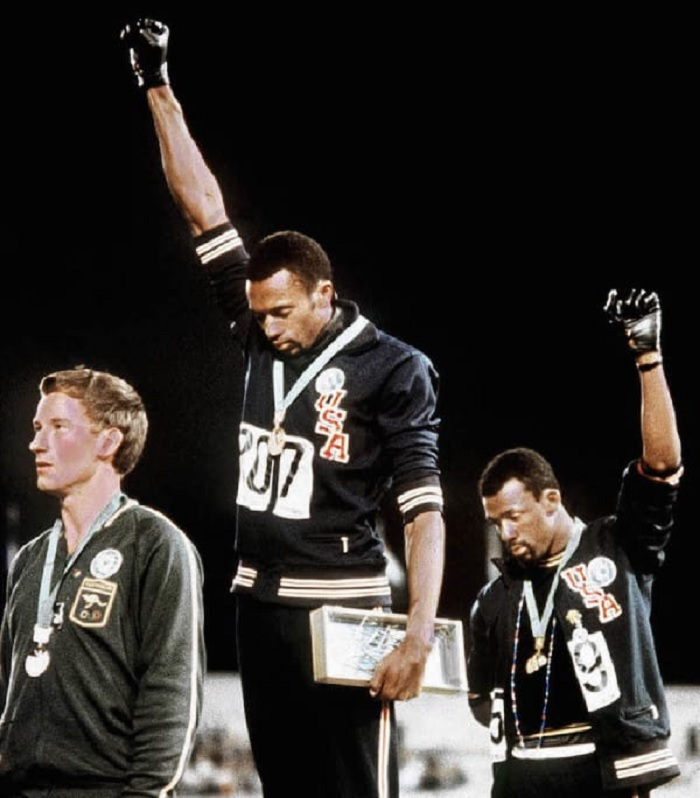 Photo Credits: https://www.reddit.com/r/HistoryPorn/comments/3p82mc/with_one_glove_each_tommie_smith_is_on_the_gold/